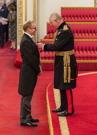 Roger Smith receives his OBE from Charles, Prince of Wales