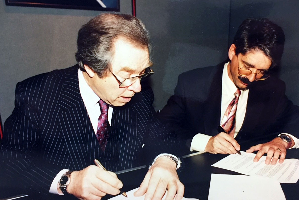 George Daniels is shown signing the agreement to adopt his Co-axial escapement with ETA in 1994